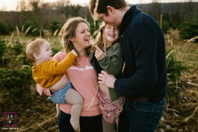 Doubs Family posing for a Lifestyle portrait showing how to be together outdoors in the sunshine