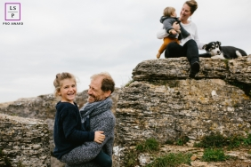Doubs Family posing for a Lifestyle portrait while playing with daddy on the rocks