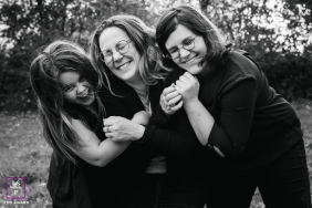 Bourgogne-Franche-Comte Family posing for a Lifestyle portrait with a BW hug with mom