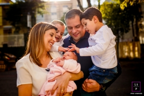 Curitiba Family posing for a Lifestyle portrait with them all blessing the newborn baby