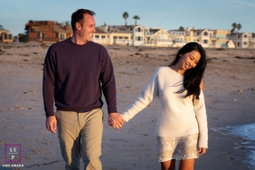 California couple Lifestyle image with some walking and laughing together on the beach