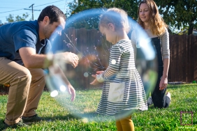 Ventura Family Lifestyle portrait with some bubble framing girl