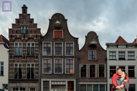 Deventer couple posing for a creative Lifestyle image near buildings in Netherlands