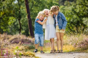 Amsterdam Kids posing for a Lifestyle portrait on a walking trail outdoors in nature