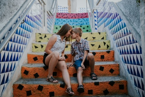 Family Photographer for Ile-de-France   Lifestyle Image: Brother and Sister love the colors on these stairs