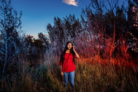 Boulder, Colorado teen girl in front of colored foliage during senior session