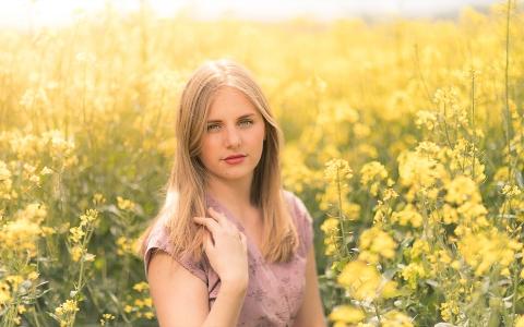 Vendee, Pays de la Loire Teen portrait in yellow fields of France countyrside