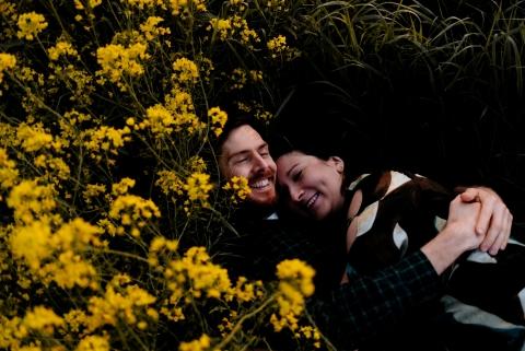 Netherlands couple photoshoot amongst plant with yellow flowers