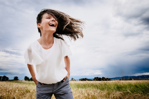 A teen photoshoot of a girl playing with the wind in her hair | France Lifestyle Photography