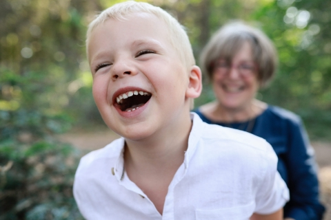 Bourgogne-Franche-Comte child Having a blast with grandma during a France lifestyle family portrait session