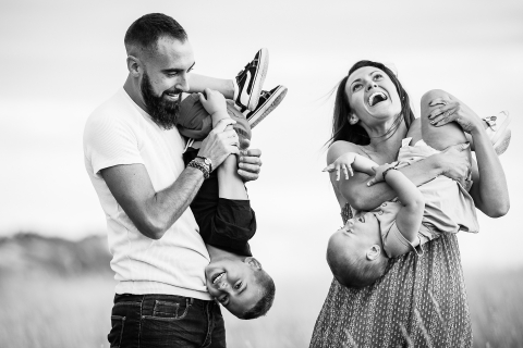 France upside down lifestyle family pictures with mom, dad and two kids out in nature