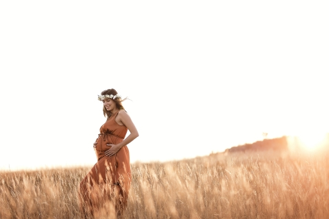 Bourgogne-Franche-Comte lifestyle maternity portrait session in an open grass field with afternoon sun in France