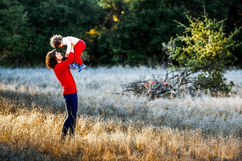 lifestyle family pictures from San Francisco showing Mommy-daughter happy time together in the grass fields and sunlight