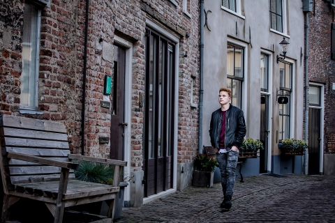 A Netherlands lifestyle teen portrait session in Gelderland with a young man Chilling in town