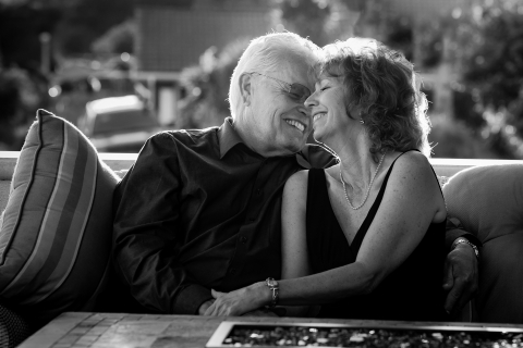 A Ventura older couple sharing a laugh as they hang out together during their California lifestyle photo session