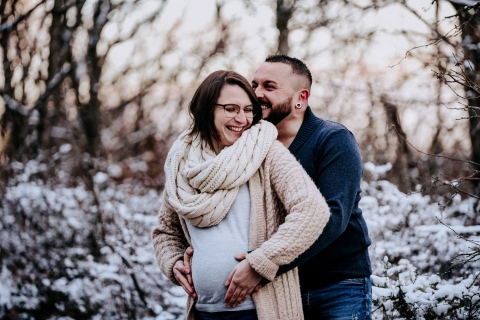 Auvergne-Rhone-Alpes winter maternity portrait with a couple
