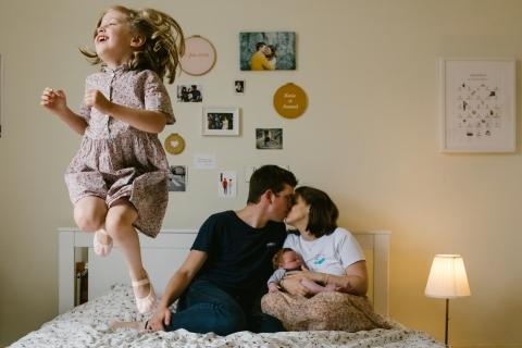 Doubs Bourgogne-Franche-Comte indoor, at-home family shoot with kids jumping on the bed