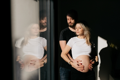 Occitanie Creative Lifestyle light and shadow maternity portrait with glass reflection