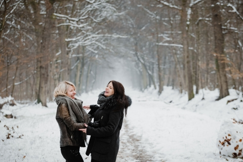 Auvergne-Rhone-Alpes Lifestyle Photographer created this artistic portrait showing Complicity of cousins in the winter snow in the forest