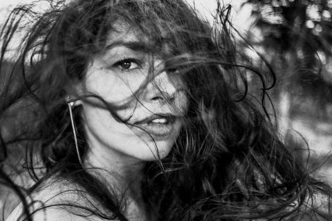 Alagoas Creative Lifestyle Portrait image capturing wind-blown hair as it combs a young woman's hair