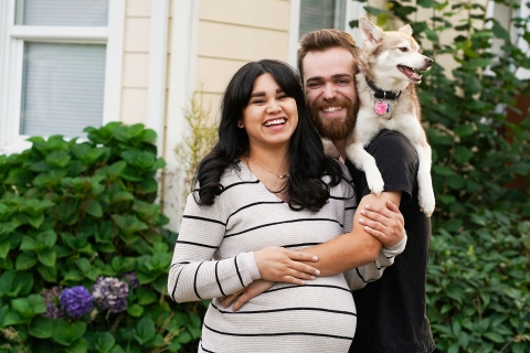 Seattle Lifestyle Photographer created this artistic portrait of a couple laughing with dog on husband's back