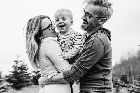 Doubs Family posing for a Lifestyle portrait with some BW outdoor laughs together