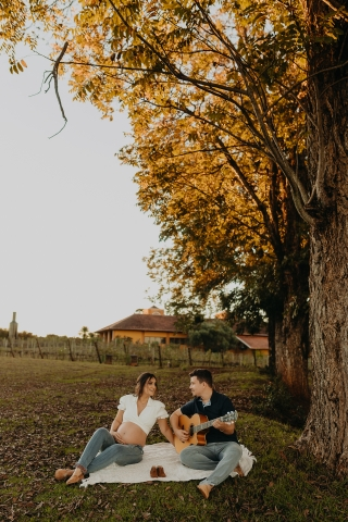 Parana couple posing for a creative Lifestyle image in a colonist family style outdoors under tall trees