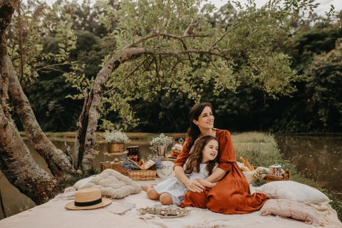 Parana Mom and Daughter posing for a Lifestyle portrait on a picnic blanket under a tree