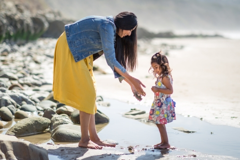 California mom and daughter playing in the sand during lifestyle beach session