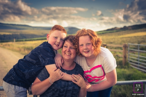 Lifestyle Family Portrait Session in Aberdeenshire Scotland | Photo contains: girl, boy, mother, pastures, gates, fences