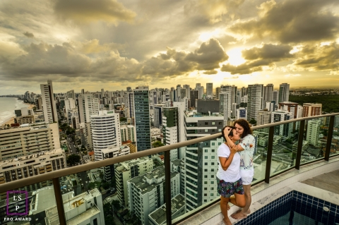 Lifestyle Couple Portrait Session in Paulista Pernambuco | Photo contains: couple, city, clouds, outdoors, color, yellow