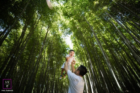Lifestyle Family Portrait Session in Hangzhou City Zhejiang | Photo contains: bamboo, baby, father, holding up, outside