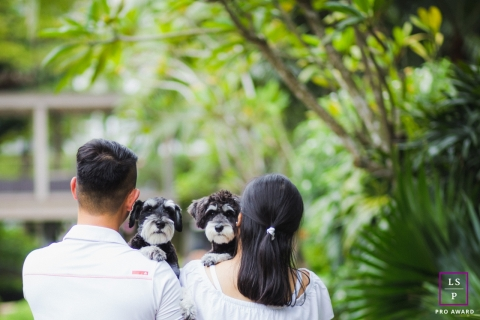 Lifestyle Couple Portrait Photography in Singapore Asia | Image contains: husband, wife, outside, palm leaves, scottish terriers