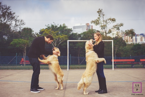 Lifestyle Couple Portrait Session in Singapore Asia | Photo contains: husband, wife, golden retrievers, hopping, soccer field
