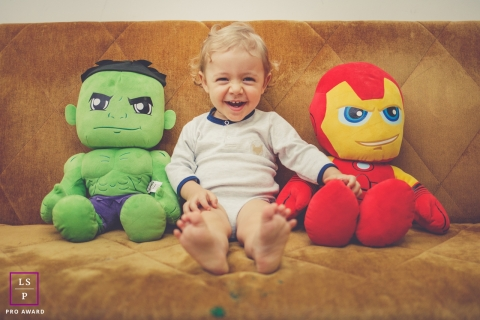 Lifestyle Family Portraits in Rio Grande do Sul Brazil - Photo contains: marvel, boy, couch, indoors, color, laughing
