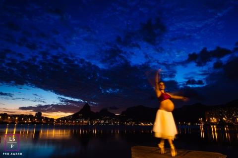 Lifestyle Maternity Portraits in Rio de Janeiro Brazil - Photo contains: sunset, blue, woman, city, bump, posing, pointe shoes