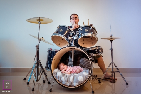 Rio de Janeiro Brazil  Family Photography - Lifestyle Portrait contains: indoor, photo, drum set, baby, sleeping, father, shushing, color
