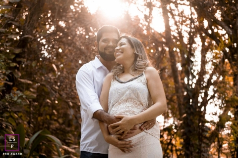 Couple Photography for Minas Gerais Brazil - Lifestyle Portrait contains: father to be, mother to be, color, trees, sunlight, bump, outdoors, hands
