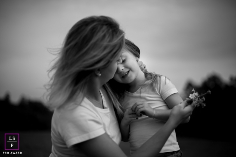 Family Photography for London England - Lifestyle Portrait contains: mother, daughter, hug, black and white