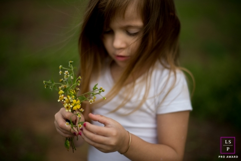 Family Photographer in London England | Lifestyle Image contains: girl, flowers, close-up
