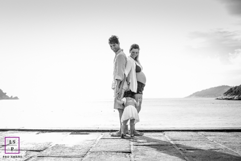 Family Photography for Rio de Janeiro Brazil - Lifestyle Portrait contains: mother, father, child, water, black and white