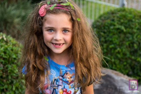 Family Portraits in Lisbon Portugal | Lifestyle Photography Session contains: girl, backyard, outdoors, rock, plants, fence