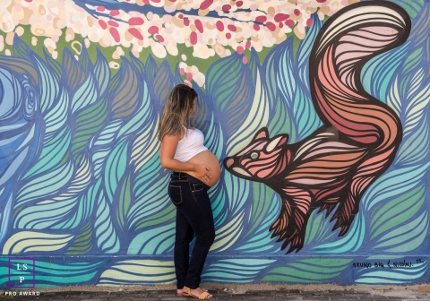 Maternity Photographer in Rio de Janeiro Brazil | Lifestyle Image contains: pregnancy, woman, mural, squirrel