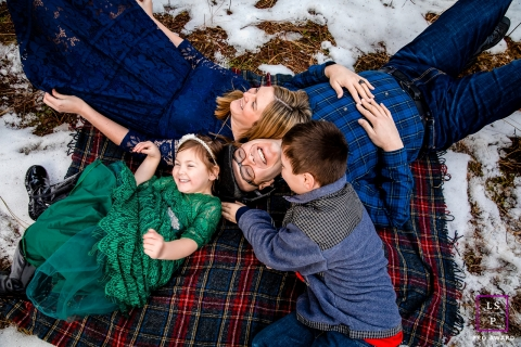 Family Photography for Coeur d'Alene Idaho - Lifestyle Portrait contains: snow, blanket, color, girl, boy, grass, outside