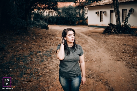 Minas Gerais Woman Lifestyle Portraits Brazil - Photo contains: girl, building, driveway, dirt, pose, ideas