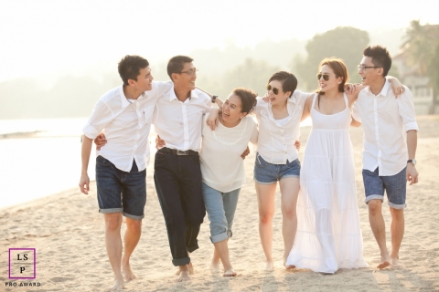 Malacca Family Lifestyle Photography Malaysia | Image contains: group picture, sand, water, shore