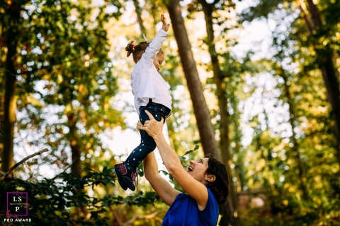 Brabant Wallon Lifestyle Family Portrait Photography Wallonie | Image contains: mother, daughter, lift, play, trees, nature, fun