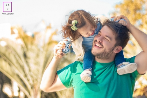 Paris Father and Daughter Lifestyle Portrait Photography Ile-de-France | Image contains: man, toddler on shoulders, trees, outdoors, nature