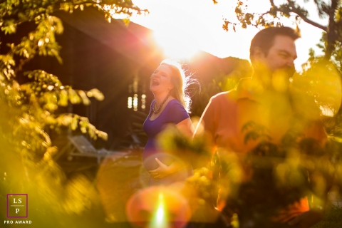 Curitiba Maternity Lifestyle Photography Session Parana | Image contains: sunlight, man, woman, pregnant, trees, home