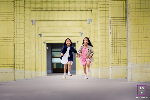 San Francisco California Kid Girls Lifestyle Portrait - Photo contains: columns, yellow, running, smiling